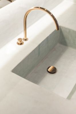 3. Think about changing your bathroom fittings. Gold could be a great choice.