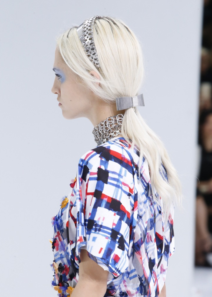 Low ponytail + silver headband + silver hair slide at Chanel.
