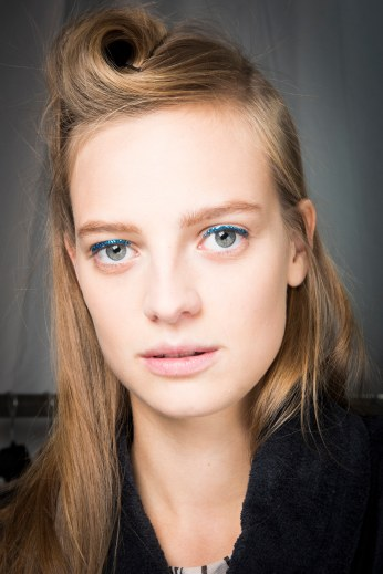 40's hairstyle + blue glittered eye shadow at Dries Van Noten.