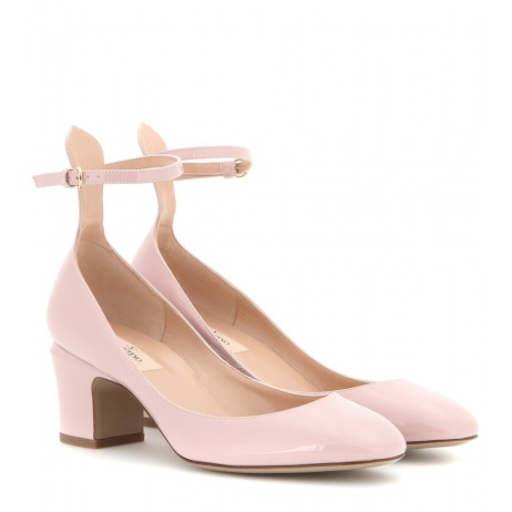 Patent leather pumps. Valentino, $636