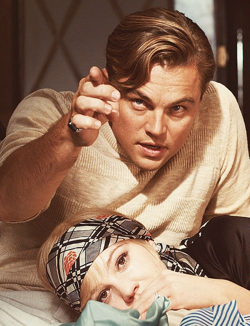 Leonardo DiCaprio as Jay Gatsby wearing a cotton t-shirt and Carey Mulligan as Daisy Buchanan wearing a silk scarf as a headband. The Great Gatsby, Baz Luhrmann (2013)