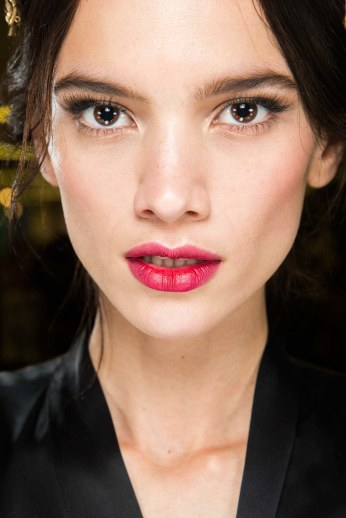 Strawberry red lips are a good alternative to classic red. Plus, the softer version of the cat-eye that is both classy and flirty. (Dolce & Gabbana, FW 2015)