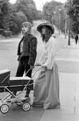 David Bowie and wife Angie taking their baby out for a walk, June 1971