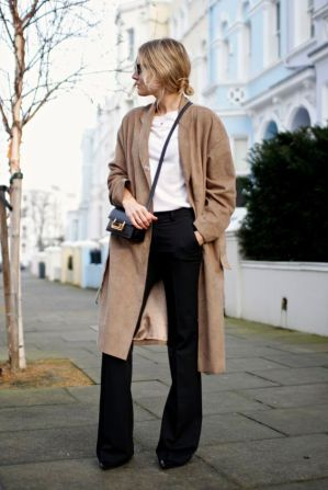 With a long camel coat. (Fashion Me Now)