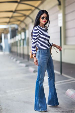 With a striped long sleeved t-shirt. (Glam Radar)