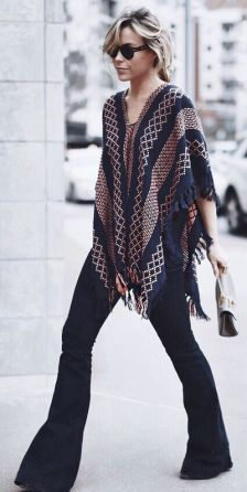With a boho inspired poncho. (Happily Grey)